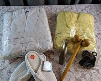 2 Robes, Slippers, Back Roller, and Shoe Shine Kit Items
