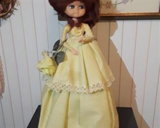 Adorable vintage doll with beehive hair. One of 2, handmade. Base is a jug, appears to be the bodice head and arms.  Hand crafted dresses.