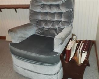 Blue velvet rocking chair, magazine holder.