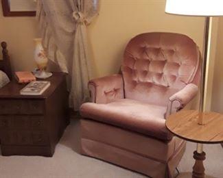 Pink velvet rocker, table lamp & nightstand.