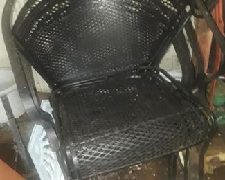 4 wrought iron chairs, matching set with table.