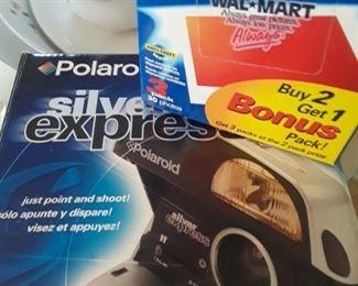 Polaroid camera and film.