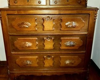 Antique five drawer chest has carved pulls