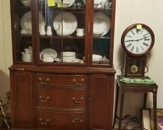 vintage china cabinet, small wooden table, wall clock