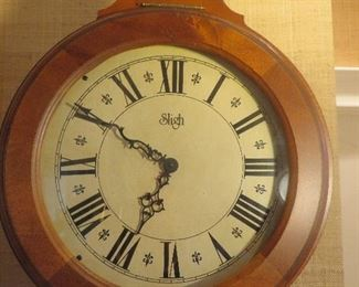 Sligh Grandfather Clock (detail of Face) Solid Wood hinged Dial Bezel.  Classic Hourglass Design.   Auburn Cherry Finish
