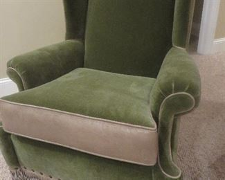 Green Mohar Swivel Rocker with Leather Piping and Fringe Trim