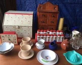 Bread box, spice racks and Nestle cups and saucers
