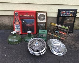 Beer signs, time clock, hub caps,  and gum display