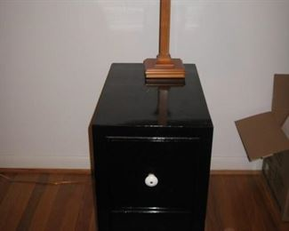 one of a pair of end tables/nightstands painted different colors