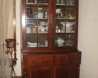 Antique step back mahogany cabinet
