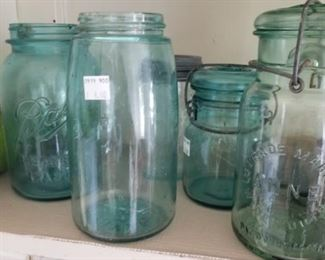 An assortment of many blue ball jars