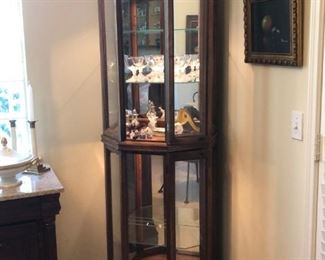 Mahogany finish corner curio cabinet with lighted interior