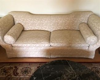 Neoclassical style sofa with custom upholstery and bolsters, circa 1920s-1930s