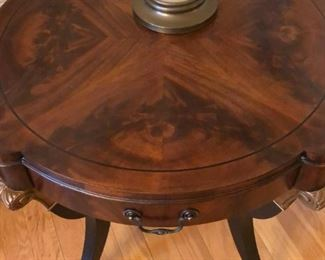 Empire style mahogany center table with book-matched top, circa 1920s-1930s