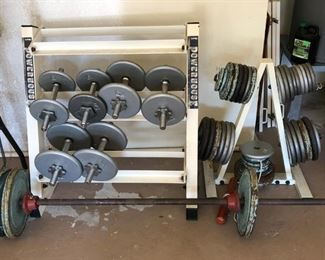 Large set of dumbbells, weights and racks