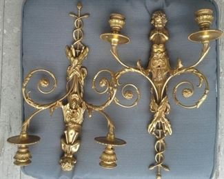Spectacular pair of mid 19th cast brass & ormolu two candle sconces, putti playing horns.
