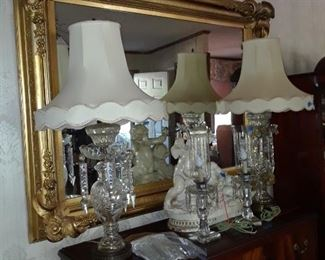 Elaborate mirrorwirh floal embellished corners; cut glass lamps with prisms; pair of electrified Art Deco era girondells