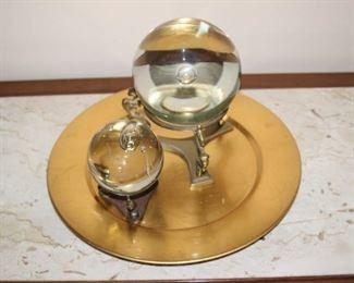 Glass balls on brass stands.