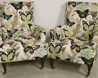 Vibrant pair butterfly arm chairs