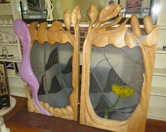 Wood and Stained Glass done by Ruth and her daughter to cover a fireplace. It can obviously be repurposed.