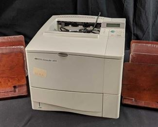 Hewlett Packard LaserJet 4050 printer and desk equipment