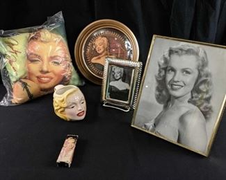 "Marilyn Monroe Lot of Collectibles- 12"" square pillow; 9""x11"" framed photo of a young Marilyn; collectible coffee mug; Marilyn Body and Bath Perfume; 5""x7"" silver tone frame with photo; wall clock ""I just want to be wonderful""."