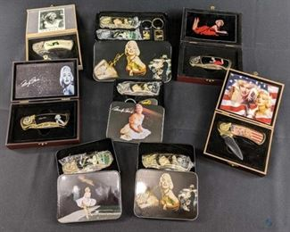 Marilyn Monroe Collectible Knife Set - 9 box set 1. Two knives set one gold, one silver with dream catcher and matching keychain. 2. American flag with two headshots of Marilyn and dream catcher gold and print on the top inside of the cover of the case. 3.Marilyn laying on the stomach in red dress gold with dream catcher print on inside of the case.