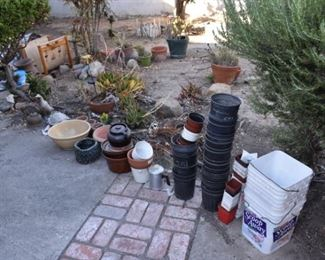 lots of planters and gardening supplies / tools