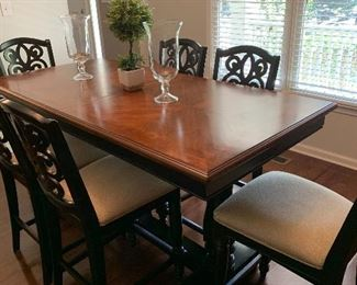 Bar height dining table seats 8 and extends to 96 inches