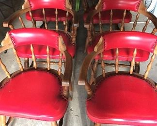 6 red club chairs