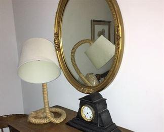 mirror, rope lamp and antique clock