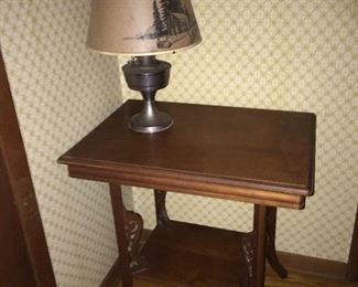 carved table (oil lamp not for sale)