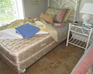 Pair of twin beds with metal white frames