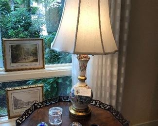 close up of one of a pair of porcelain based lamps for sale asking $180