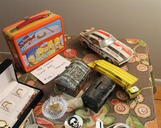 Vintage car and truck toys, vintage banks, and collectible Simpsons lunchbox w/ thermos