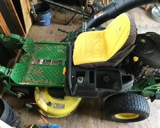 Mower is a 2013 with 137 hours on it and a 2 bag grass catcher. Stored in a shed.