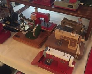 some the wee toy sewing machines-many of them-some with original boxes