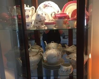 teapots in lighted cabinet