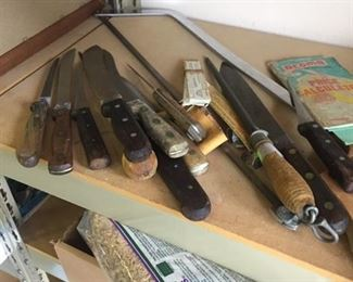 meat saw and old butcher's knives