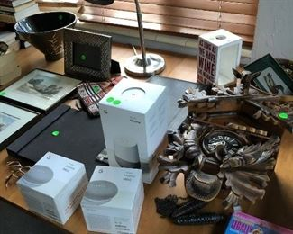 Google Home system brand new in original packing; MCM cuckoo clock from Germany; British engravings framed.