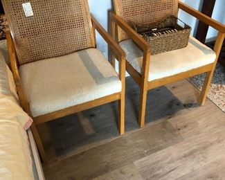 Two of four available; MCM cane arm dining chairs.