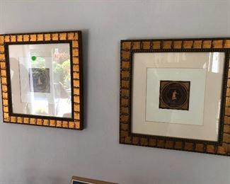 Framed engravings.