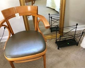 MCM Bentwood chair in front of gilded mirror.