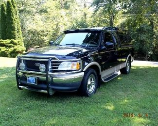ONLINE AUCTION ITEM #1 - 2000 Ford F-150 Lariat - just over 43,000 original miles, one owner, new tires, leather, power windows / doors / seats, FM/AM CD changer, 5.4 liter engine, custom fiberglass camper top, spray in Rhino liner. Awesome truck!!!