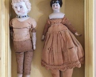 Antique porcelain head dolls...... very, very old.