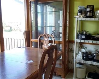 Oak and glass curio and matching table & chairs with host chair and 2 extra leaves
