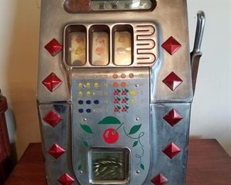 5¢ Bar Top Slot Machine ready to go in your man cave.
