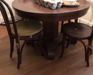 Antique round oak table with bentwood chairs