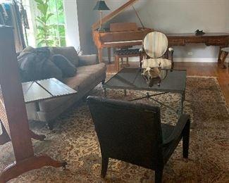 Piano $9000.00 Sofa $800.00 Leather crocodile chair $150.00 Rug $7000.00