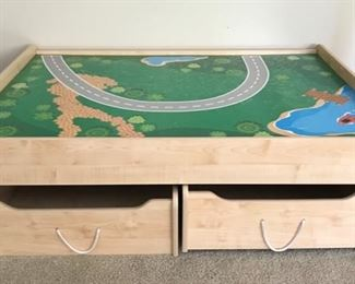 Train table suitable for Thomas Train or similar sets. Many accessories(train cars, track, bridges, etc.) included with the table. THIS IS PRICED TO SELL!